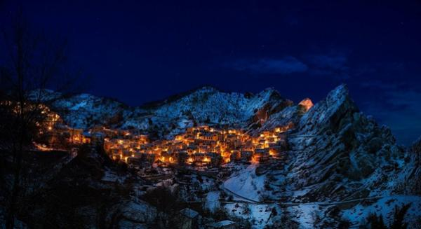 Village in the mountains at night