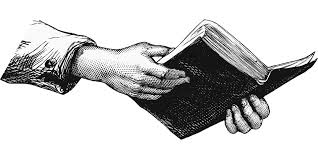 hands holding a book