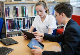 Students using tablets and computer equipment