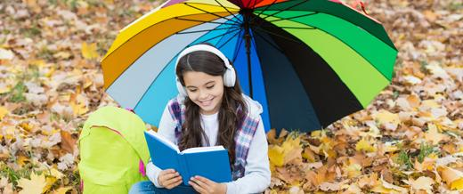 Girl reading umbrella