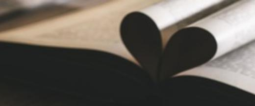book with pages bending to form a heart shape