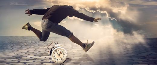 Man jumping over a clock