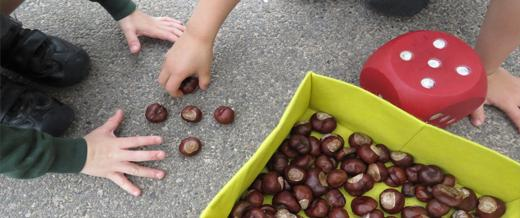 Children with large dice and conkers
