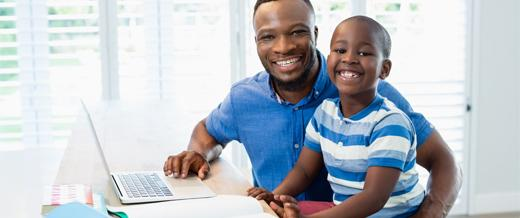 Father with child at computer