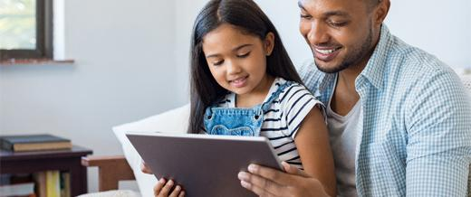 Child with parent on tablet