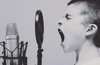 Boy singing into microphone